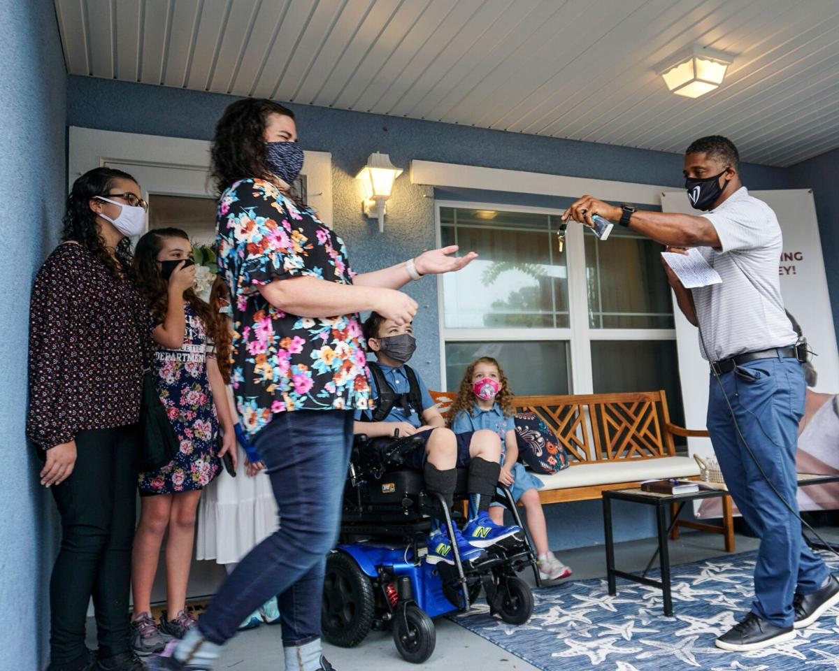 A handoff with heart: Habitat for Humanity, Warrick Dunn, Denard Span team up to set up Largo mother of 6 with home
